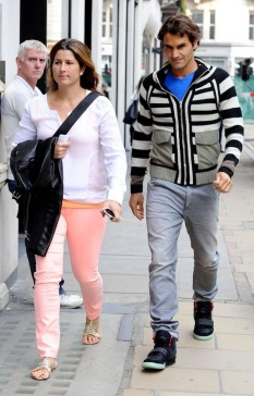 Roger-Federer-wearing-Alexander-McQueen-Cardigan-and-Nike-Air-Yeezy-2-Solar-Red-Sneakers